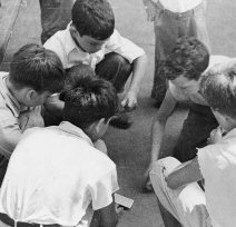 Boys playing cards in 1935, from the Library of Congress collection.
